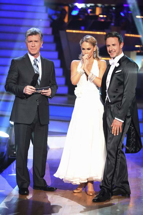 Actor David Arquette and his partner Kym Johnson talk with 'Dancing With The Stars' co-host Tom Bergeron after being safe from elimination on 'Dancing With Th