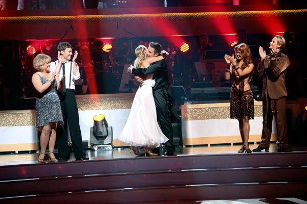 Actor David Arquette and his partner Kym Johnson react to being safe from elimination on 'Dancing With The Stars: The Results Show' on Tuesday, September 20, 2011. The pair received 18 out of 30 from the judges for their Viennese Waltz on