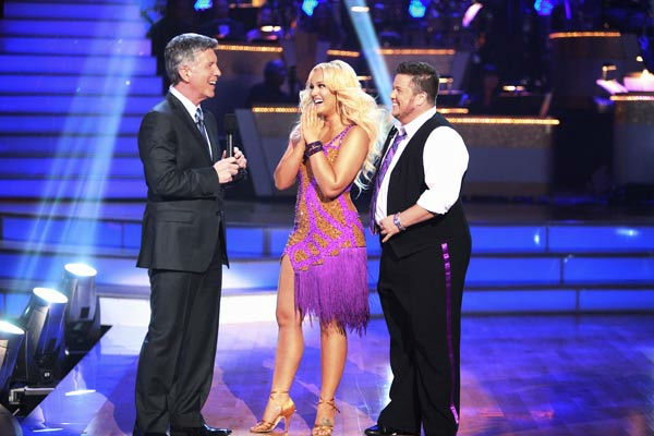 LGBT activist Chaz Bono and his partner Lacey Schwimmer talk with 'Dancing With The Stars' co-host Tom Bergeron after being safe from elimination on 'Dancing With The Stars: The Results Show' on Tuesday, September 20, 2011.The pair received 17 out of 30 f