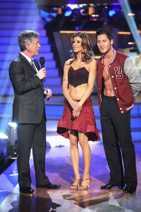 Italian model and actress Elisabetta Canalis and her partner Valentin Chmerkovskiy talk with 'Dancing With The Stars' co-host Tom Bergeron after being safe from elimination on 'Dancing With The Stars: The Results Show'