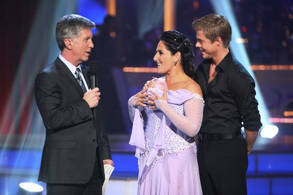Talk show host and actress Ricki Lake and her partner Derek Hough talk with 'Dancing With The Stars' co-host Tom Bergeron after being safe from elimination on 'Dancing With The Stars: T