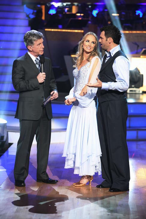 Singer Chynna Phillips and her partner Tony Dovolani talk with 'Dancing With The Stars' co-host Tom Bergeron after being safe from elimination on 'Dancing With The Stars: The Results Show' on Tuesday, September 20, 2011.The pair received 22 out of 30 from