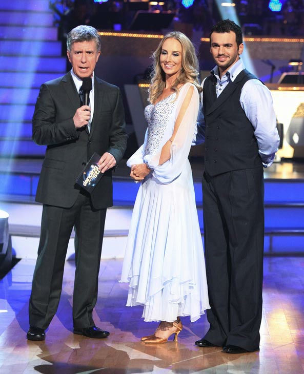 Singer Chynna Phillips and her partner Tony Dovolani talk with 'Dancing With The Stars' co-host Tom Bergeron after being safe from elimination on 'Dancing With The Stars: The Results Show' on Tuesday, September 20, 2011.The pair received 22 out of 30 f