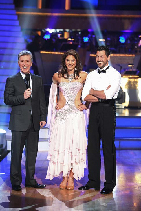 "<div class=""meta ""><span class=""caption-text "">U.S. soccer star Hope Solo and her partner Maksim Chmerkovskiy talk with 'Dancing With The Stars' co-host Tom Bergeron after being safe from elimination on 'Dancing With The Stars: The Results Show' on Tuesday, September 20, 2011. The pair received 19 out of 300 from the judges for their Cha cha cha on the season premiere of 'Dancing With The Stars.' (ABC Photo/ Adam Taylor)</span></div>"
