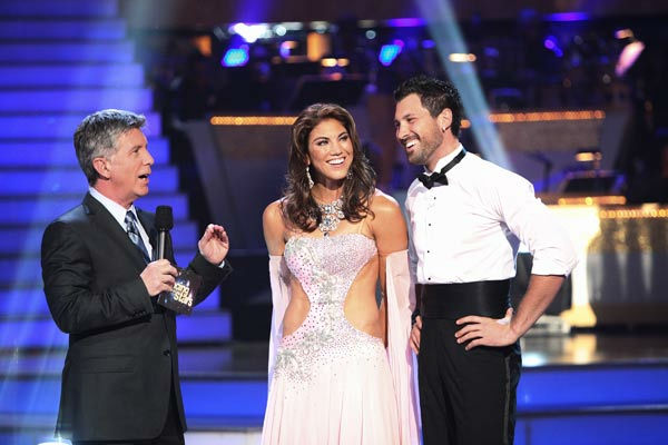 U.S. soccer star Hope Solo and her partner Maksim Chmerkovskiy talk with 'Dancing With The Stars' co-host Tom Bergeron after being safe from elimination on 'Dancing With The Stars: The Results Show' on Tuesday, September 20, 2011. The pair received 19 out