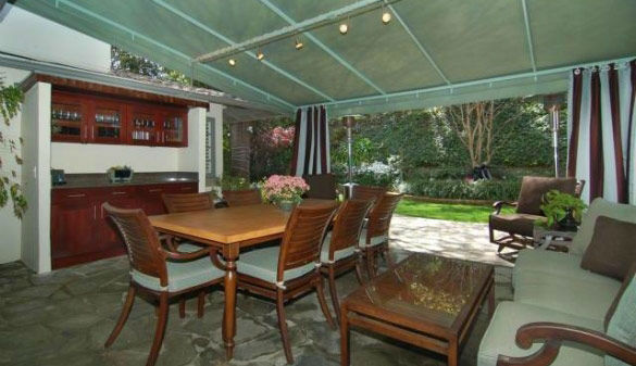 The patio dining room at 'Gossip Girl' actress Leighton Meester's new Encino, California home. The 2,847 square feet property is located on a lush hillside and has 4 bedrooms, 4.5 bathrooms, a black-bottomed pool and pool bar. The one-story house was buil