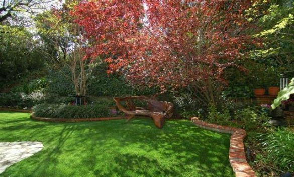 The garden at 'Gossip Girl' actress Leighton Meester's new Encino, California home. The 2,847 square feet property is located on a lush hillside and has 4 bedrooms, 4.5 bathrooms, a black-bottomed pool and pool bar. The one-story house was built in 1948 a