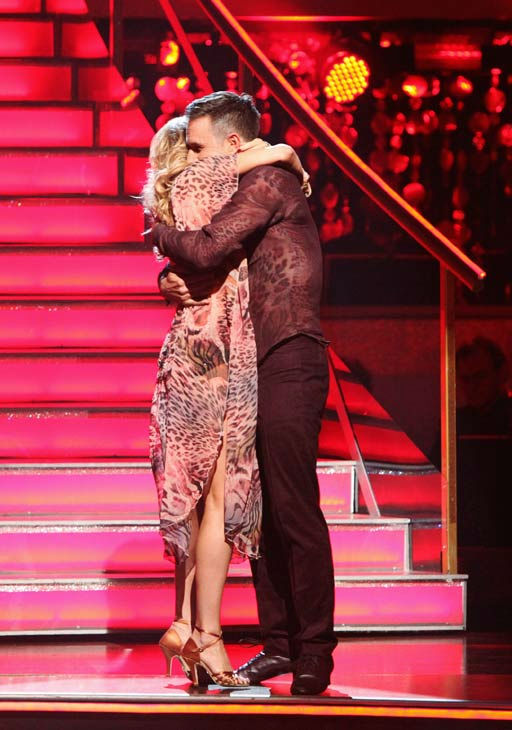 "<div class=""meta ""><span class=""caption-text "">Actor David Arquette and his partner Kym Johnson react to being safe from elimination on 'Dancing With The Stars: The Results Show' on Tuesday, October 4, 2011. The pair received 24 out of 30 from the judges for their Rumba on the October 3 episode of 'Dancing With The Stars.' (ABC Photo/ Adam Taylor)</span></div>"