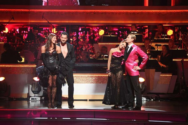 "<div class=""meta ""><span class=""caption-text "">The remaining couples waited to see who would be eliminated, as determined by a combination of the judges' scores and viewers' votes on dances performed on Monday's performance show, on 'Dancing With The Stars: The Results Show' on Tuesday, October 4, 2011. (Pictured: HOPE SOLO, MAKSIM CHMERKOVSKIY, ANNA TREBUNSKAYA, CARSON KRESSLEY.) (ABC Photo/ Adam Taylor)</span></div>"