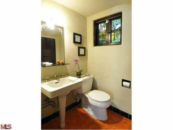 "<div class=""meta image-caption""><div class=""origin-logo origin-image ""><span></span></div><span class=""caption-text"">A guest bathroom in Frances Bean Cobain's 3,350 square foot home, which the only child of Courtney Love and the late Kurt Cobain purchased for $1,825,000 in July, 2011. The property, which was built in 1930 by architect Carl Jules Weyl, has 4-bedrooms and 3.5 bathrooms. (Photo/MLS Listings)</span></div>"