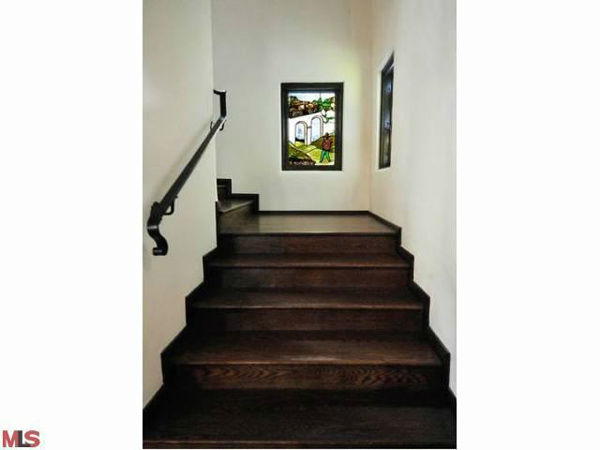 The staircase in Frances Bean Cobain&#39;s 3,350 square foot home, which the only child of Courtney Love and the late Kurt Cobain purchased for &#36;1,825,000 in July, 2011. The property, which was built in 1930 by architect Carl Jules Weyl, has 4-bedrooms and 3.5 bathrooms. <span class=meta>(Photo&#47;MLS Listings)</span>