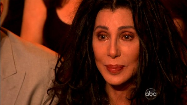 Cher reacts to her son LGBT activist Chaz Bono and his partner Lacey Schwimmer dance the Paso Doble on the October 3 episode of 'Dancing With The Stars.'