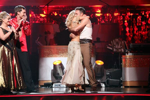 "<div class=""meta ""><span class=""caption-text "">Actor David Arquette and his partner Kym Johnson react to being safe from elimination on 'Dancing With The Stars: The Result Show' on Tuesday, October 11, 2011. The received 23 out of 30 from the judges for their Paso Doble on the October 10 episode of 'Dancing With The Stars.'  (ABC Photo/ Adam Taylor)</span></div>"