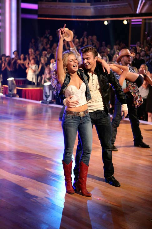 "<div class=""meta ""><span class=""caption-text "">'Dancing With the Stars' two-time champion Julianne Hough and 'Footloose' co-star Kenny Wormald joined Country Music Awards Entertainer of the Year nominee Blake Shelton his performance of the 'Footloose' theme song on 'Dancing With The Stars: The Result Show' on Tuesday, October 11, 2011. (ABC Photo/ Adam Taylor)</span></div>"