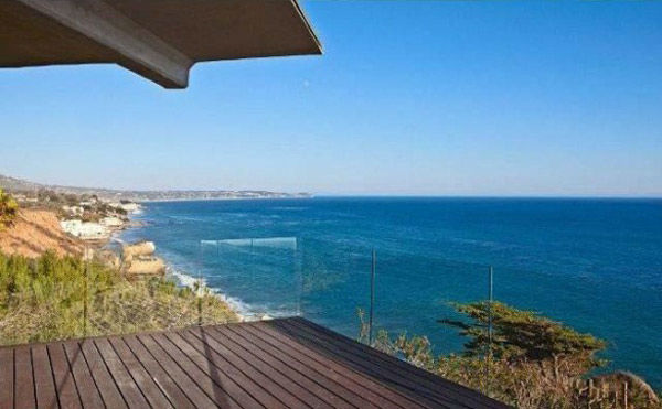 The balcony at Brad Pitt&#39;s Mid-Century Modern Malibu beach house which the actor put on the market for &#36;13.75 million. The 4,088 square foot home, which was designed by architect Chris Sorenson, has 4-bedrooms, 4-bathrooms, a swimming pool and ocean views. <span class=meta>(Photo&#47;Realtor.com)</span>