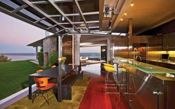The kitchen in Brad Pitt&#39;s Mid-Century Modern Malibu beach house which the actor put on the market for &#36;13.75 million. The 4,088 square foot home, which was designed by architect Chris Sorenson, has 4-bedrooms, 4-bathrooms, a swimming pool and ocean views. <span class=meta>(Photo&#47;Realtor.com)</span>