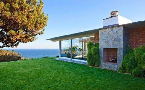 The exterior of Brad Pitt's Mid-Century Modern...