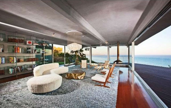 The sitting room in Brad Pitt&#39;s Mid-Century Modern Malibu beach house which the actor put on the market for &#36;13.75 million. The 4,088 square foot home, which was designed by architect Chris Sorenson, has 4-bedrooms, 4-bathrooms, a swimming pool and ocean views. <span class=meta>(Photo&#47;Realtor.com)</span>