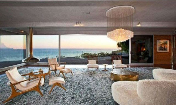 The sitting room in Brad Pitt's Mid-Century Modern Malibu beach house which the actor put on the market for $13.75 million. The 4,088 square foot home, which was designed by architect Chris Sorenson, has 4-bedrooms, 4-bathrooms, a swimming pool and ocean