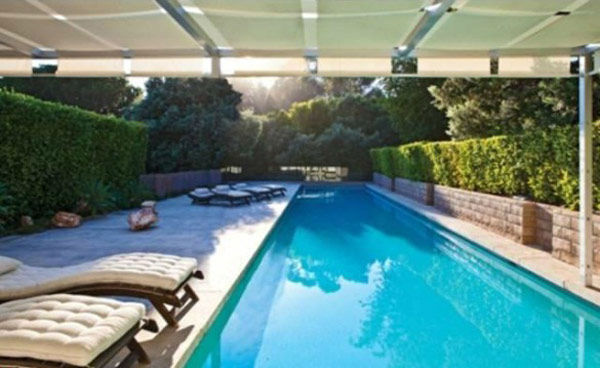 The lap pool at Brad Pitt&#39;s Mid-Century Modern Malibu beach house which the actor put on the market for &#36;13.75 million. The 4,088 square foot home, which was designed by architect Chris Sorenson, has 4-bedrooms, 4-bathrooms, a swimming pool and ocean views. <span class=meta>(Photo&#47;Realtor.com)</span>