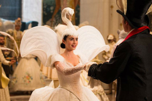 Lily Collins and Armie Hammer appear in a scene...