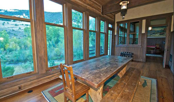"<div class=""meta ""><span class=""caption-text "">The breakfast nook in the main house on Dennis Quaid's $14 million ranch property, which the actor bought 25-years ago from director Sam Peckinpah and actor Warren Oates. The 5315 square foot home, which Quaid built in 2000 with architect Frank Cikan, has 3 bedrooms, 3 1/2 bathrooms and features wide-plank hardwood floors salvaged from the Great Chicago Fire of 1871. There are also four guest houses, a ranch manager's home, a creek, horse facilities and an observatory. (Photo/Sothebysrealty.com)</span></div>"