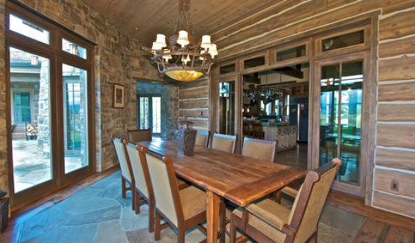 "<div class=""meta ""><span class=""caption-text "">The dining room in the main house on Dennis Quaid's $14 million ranch property, which the actor bought 25-years ago from director Sam Peckinpah and actor Warren Oates. The 5315 square foot home, which Quaid built in 2000 with architect Frank Cikan, has 3 bedrooms, 3 1/2 bathrooms and features wide-plank hardwood floors salvaged from the Great Chicago Fire of 1871. There are also four guest houses, a ranch manager's home, a creek, horse facilities and an observatory. (Photo/Sothebysrealty.com)</span></div>"