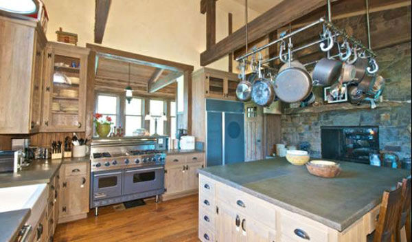 "<div class=""meta ""><span class=""caption-text "">The kitchen in the main house on Dennis Quaid's $14 million ranch property, which the actor bought 25-years ago from director Sam Peckinpah and actor Warren Oates. The 5315 square foot home, which Quaid built in 2000 with architect Frank Cikan, has 3 bedrooms, 3 1/2 bathrooms and features wide-plank hardwood floors salvaged from the Great Chicago Fire of 1871. There are also four guest houses, a ranch manager's home, a creek, horse facilities and an observatory. (Photo/Sothebysrealty.com)</span></div>"