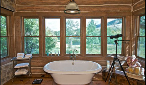 "<div class=""meta ""><span class=""caption-text "">The master bathroom in the main house on Dennis Quaid's $14 million ranch property, which the actor bought 25-years ago from director Sam Peckinpah and actor Warren Oates. The 5315 square foot home, which Quaid built in 2000 with architect Frank Cikan, has 3 bedrooms, 3 1/2 bathrooms and features wide-plank hardwood floors salvaged from the Great Chicago Fire of 1871. There are also four guest houses, a ranch manager's home, a creek, horse facilities and an observatory. (Photo/Sothebysrealty.com)</span></div>"