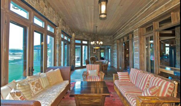 "<div class=""meta ""><span class=""caption-text "">A sitting room in the main house on Dennis Quaid's $14 million ranch property, which the actor bought 25-years ago from director Sam Peckinpah and actor Warren Oates. The 5315 square foot home, which Quaid built in 2000 with architect Frank Cikan, has 3 bedrooms, 3 1/2 bathrooms and features wide-plank hardwood floors salvaged from the Great Chicago Fire of 1871. There are also four guest houses, a ranch manager's home, a creek, horse facilities and an observatory. (Photo/Sothebysrealty.com)</span></div>"