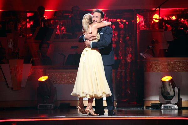 "<div class=""meta ""><span class=""caption-text "">Actor David Arquette and his partner Kym Johnson react to being safe from elimination on 'Dancing With The Stars: The Results Show' on Tuesday, October 25, 2011. The pair received 23 out of 30 from the judges for their Quickstep on the October 24 episode of 'Dancing With The Stars.' (ABC Photo/ Adam Taylor)</span></div>"