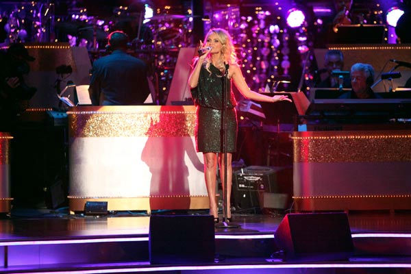 "<div class=""meta ""><span class=""caption-text "">Kristin Chenoweth returned to the 'Dancing With The Stars' stage on Tuesday, October 25, to perform 'Lessons Learned' from her new album, 'Some Lessons Learned.' The Broadway veteran was accompanied by pro dancers Tony Dovolani and Dasha Chesnokova.  (ABC Photo/ Adam Taylor)</span></div>"