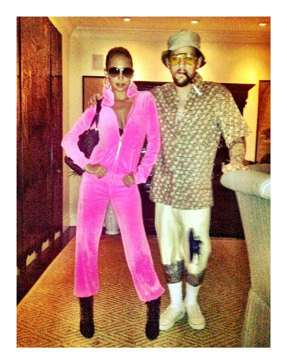 "<div class=""meta ""><span class=""caption-text "">'Don't be fooled by the rocks dat we got! HAPPY HALLOWEEN! Love JLo & Hunter S. Thomson,' Nicole Richie wrote on her official Twitter page on Sunday, October 30, 2011. Richie appears as Jennifer Lopez in the photo while her husband, Joel Madden, is dressed as Hunter S. Thomson. (Twitter.com/NicoleRichie)</span></div>"