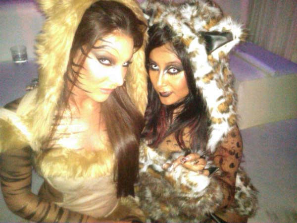 'Jersey Shore' star Nicole 'Snooki' Polizzi dressed up as a cat for Halloween. She is seen above with her friend Ryder <a href='https://twitter.com/#!/Sn00ki/s