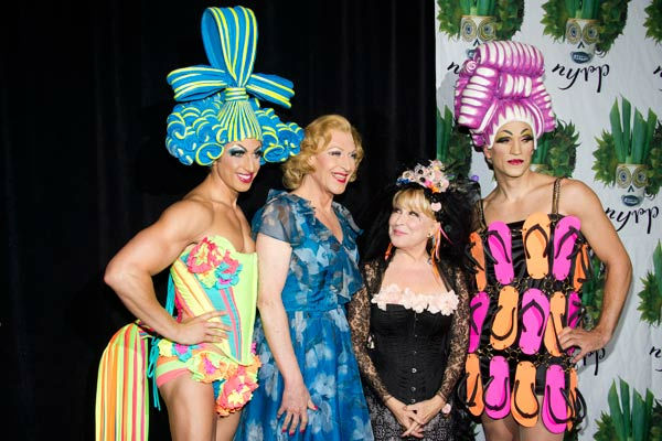 Bette Midler, second from right, poses with cast members from the Broadway show 'Priscilla, Queen of the Desert' at her Hulaween gala benefit for the New York Restoration Project, in New York, Friday, Oct. 28, 2011.
