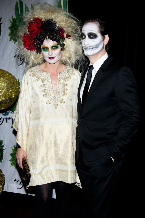 Debra Messing and Daniel Zelman attend Bette Midler's Hulaween gala benefit for the New York Restoration Project, in New York, Friday, Oct. 28, 2011.