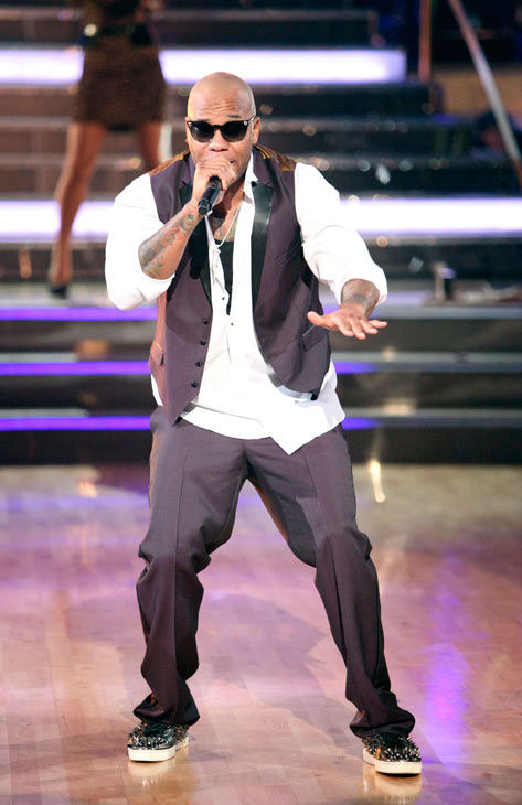 "<div class=""meta ""><span class=""caption-text "">Miami-based rapper Flo Rida also hit the stage with a medley of two of his chart topping singles, 'Club Can't Handle Me' and 'Good Feeling' on 'Dancing With The Stars: The Results Show' on Tuesday, November 8, 2011. The Troupe accompanied their performance.  (ABC Photo/ Adam Taylor)</span></div>"