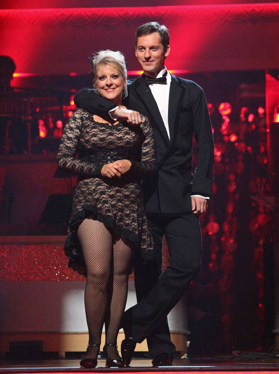 "<div class=""meta ""><span class=""caption-text "">Nancy Grace and her partner Tristan Macmanus await possible elimination on 'Dancing With The Stars: The Result Show' on Tuesday, November 8, 2011. The pair received 24 out of 30 from the judges for their Tango and 20 out of 30 for their Instant Jive, for a total of 44 on the November 7 episode of 'Dancing With The Stars.'  (ABC Photo/ Adam Taylor)</span></div>"