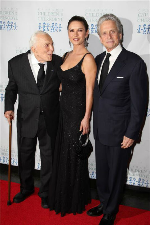 Catherine Zeta-Jones and Michael Douglas pose with his father, actor Kirk Douglas, at the Children At Heart Gala, hosted by  Children of Chernobyl, to mark the Chernobyl disaster&#39;s 25th anniversary, in New York on Nov. 21, 2011. <span class=meta>(Amanda Schwab &#47; Startraksphoto.com)</span>