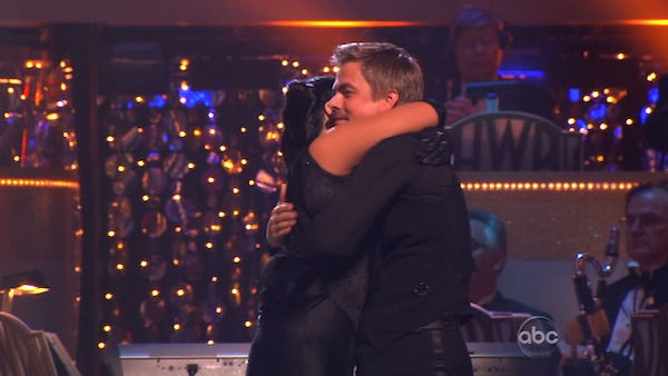 "<div class=""meta image-caption""><div class=""origin-logo origin-image ""><span></span></div><span class=""caption-text"">Talk show host and actress Ricki Lake and her partner Derek Hough react to being eliminated on 'Dancing With The Stars: The Results Show' on Tuesday, November 22. Also pictured: Co-hosts Tom Bergeron and Brooke Burke. (ABC / Adam Taylor)</span></div>"
