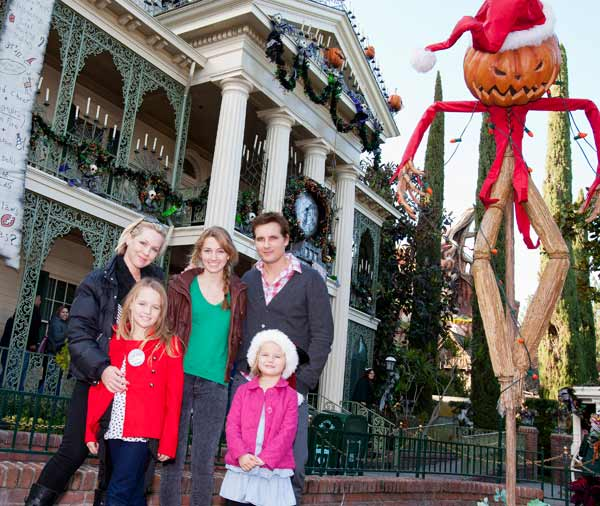 Jennie Garth and then-husband Peter Facinelli pose with daughters, from left, Lola Ray, 9, Luca Bella, 14, and Fiona Eve, 5, outside the Haunted Mansion Holiday seasonal attraction at Disneyland, in Anaheim, California on Friday, Dec. 16, 2011.