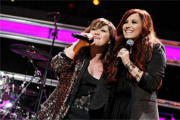 L-R: Kelly Clarkson and Demi Lovato perform together during Z100&#39;s Jingle Bell Ball 2011, presented by Aeropostale, on Dec. 9, 2011. <span class=meta>(Amanda Schwab &#47; Startraksphoto.com)</span>