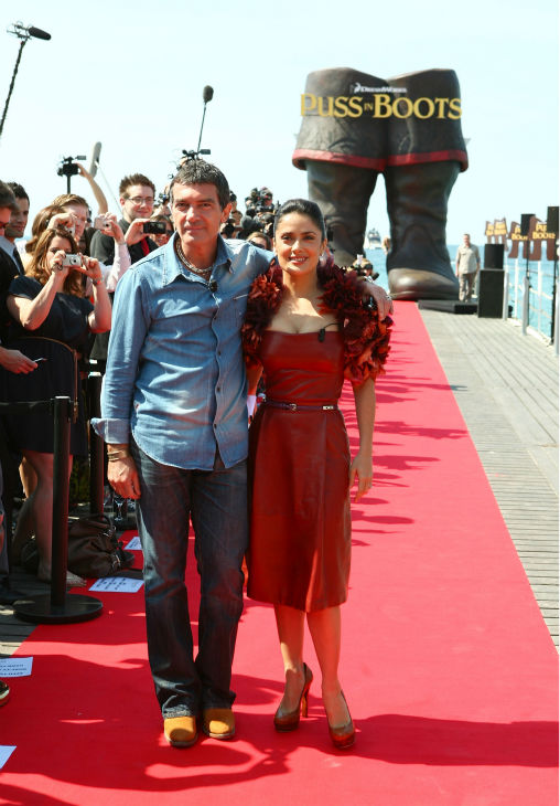 Actor Antonio Banderas (L) and actress Salma Hayek attend the 'Puss in Boots' Photocall at Carlton Beach during the 64th Cannes Film Festival on May 11, 2011 in Cannes, France.