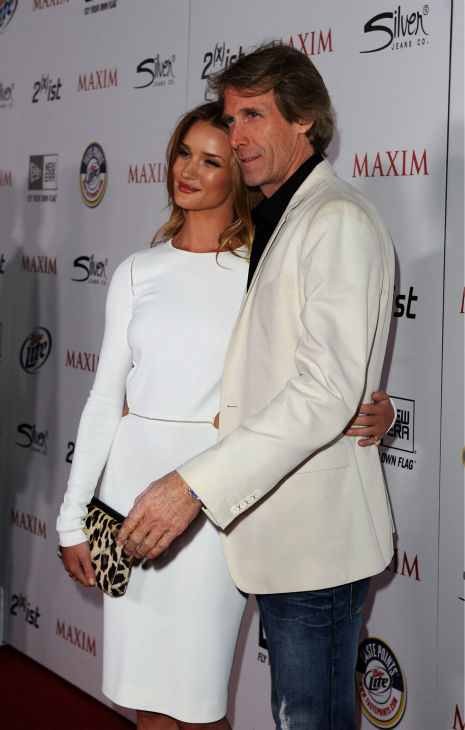 "<div class=""meta ""><span class=""caption-text "">Actress Rosie Huntington-Whiteley and Director Michael Bay arrive at the 2011 Maxim Hot 100 Party with New Era, Miller Lite, 2(x)ist and Silver Jeans Co. held at Eden on May 11, 2011 in Hollywood, California. (Jason Merritt / Getty Images / Royalty-free)</span></div>"