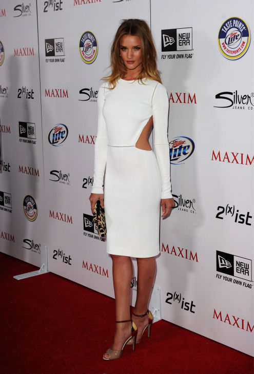 "<div class=""meta ""><span class=""caption-text "">Actress Rosie Huntington-Whiteley arrives at the 2011 Maxim Hot 100 Party with New Era, Miller Lite, 2(x)ist and Silver Jeans Co. held at Eden on May 11, 2011 in Hollywood, California. (Jason Merritt / Getty Images / Royalty-free)</span></div>"