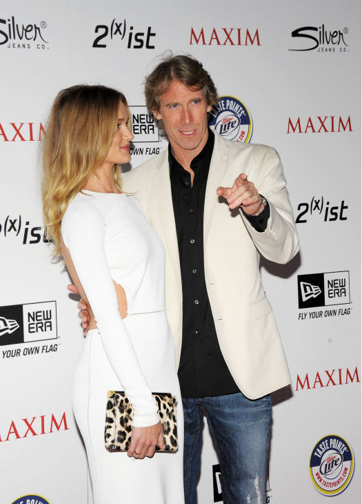 Actress Rosie Huntington-Whiteley (L) and director Michael Bay arrives at the 2011 Maxim Hot 100 Party with New Era, Miller Lite, 2(x)ist and Silver Jeans Co. held at Eden on May 11, 2011 in Hollywood, California.