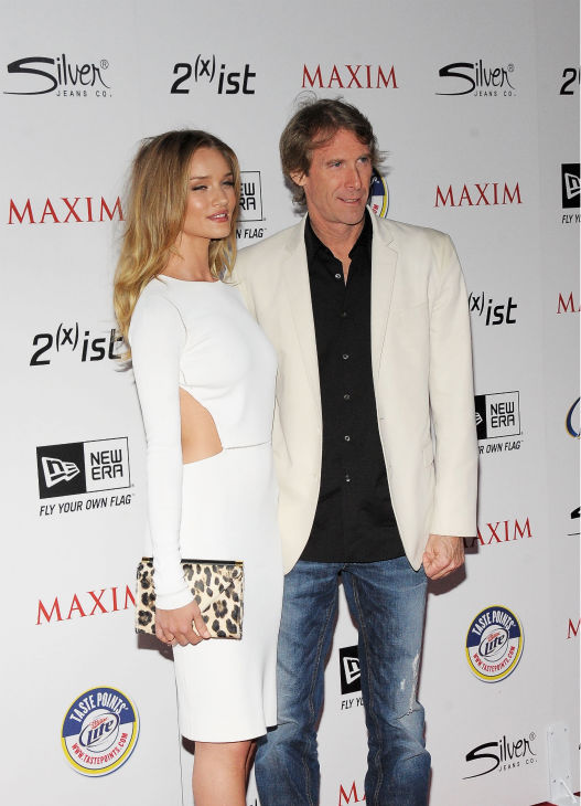 Actress Rosie Huntington-Whiteley &#40;L&#41; and director Michael Bay arrives at the 2011 Maxim Hot 100 Party with New Era, Miller Lite, 2&#40;x&#41;ist and Silver Jeans Co. held at Eden on May 11, 2011 in Hollywood, California.  <span class=meta>(Charley Gallay &#47; Getty Images &#47; Royalty-free)</span>