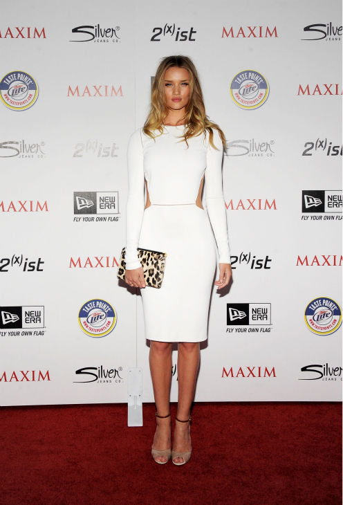 "<div class=""meta ""><span class=""caption-text "">Actress Rosie Huntington-Whiteley arrives at the 2011 Maxim Hot 100 Party with New Era, Miller Lite, 2(x)ist and Silver Jeans Co. held at Eden on May 11, 2011 in Hollywood, California. (Charley Gallay / Getty Images / Royalty-free)</span></div>"