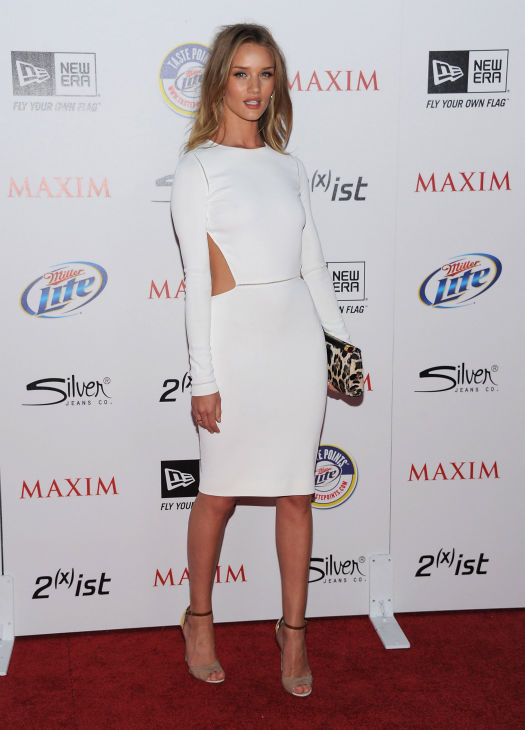 "<div class=""meta image-caption""><div class=""origin-logo origin-image ""><span></span></div><span class=""caption-text"">Actress Rosie Huntington-Whiteley arrives at the 2011 Maxim Hot 100 Party with New Era, Miller Lite, 2(x)ist and Silver Jeans Co. held at Eden on May 11, 2011 in Hollywood, California. (Angela Weiss / Getty Images / Royalty-free)</span></div>"