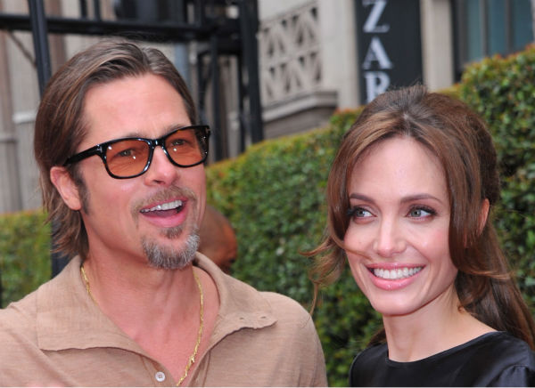 Angelina Jolie and Brad Pitt arrive at...